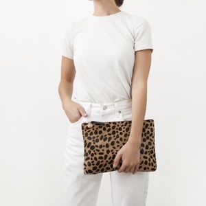 Claire V leopard hair flat clutch bag